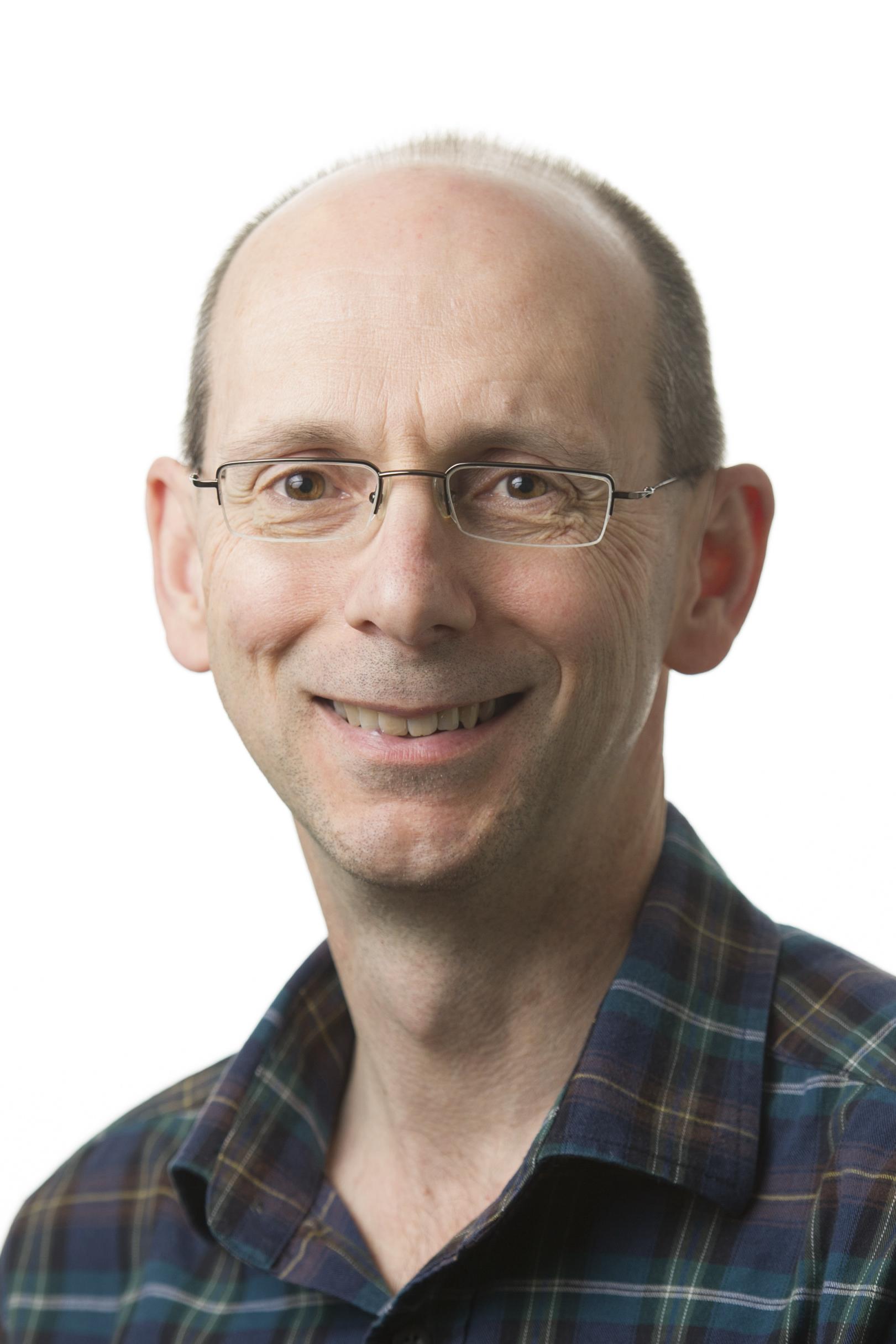 Professor Christopher J Poulos